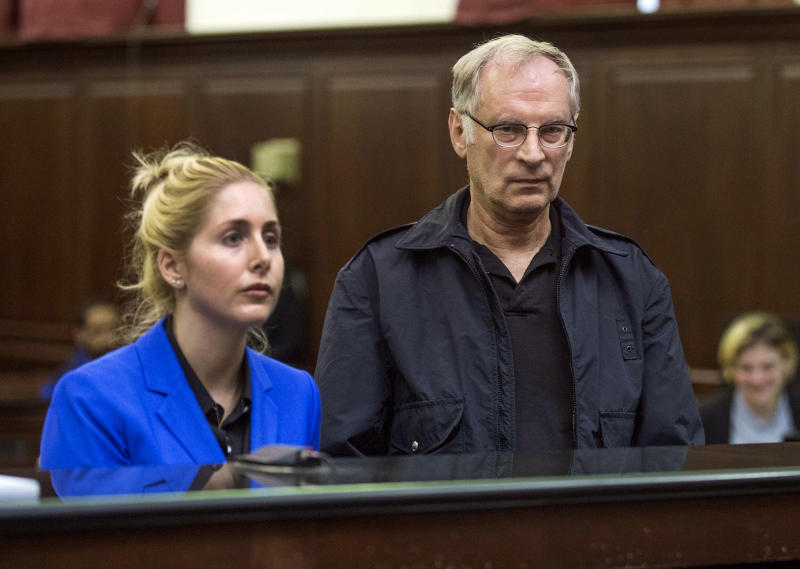 Bernhard Goetz, right, stands with attorney Danielle Iredale, as he is arraigned in Manhattan criminal court, in New York, Saturday, Nov. 2, 2013. Subway vigilante Goetz, who ignited a national furor over racism and gun control after he shot four panhandling youths on a train in the 1980s, was arrested on drug charges. (AP Photo/New York Post, Steven Hirsch, Pool)