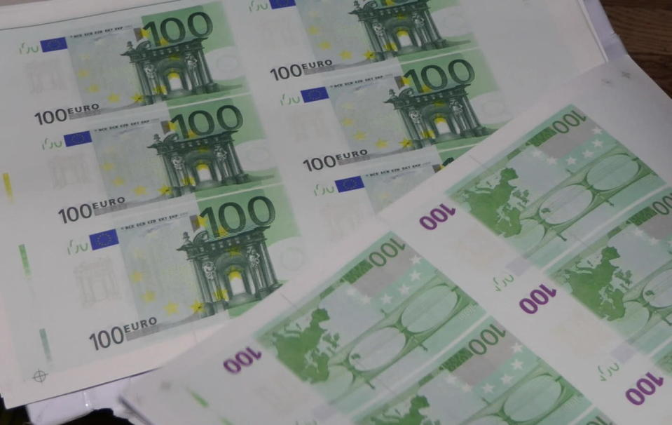 In this photo provided by Bulgaria's Interior Ministry on Tuesday, March 16, 2021, counterfeit money at a printing office in a university in Sofia. Bulgarian authorities say they have seized high-quality forged banknotes produced at a printing office in a university in the Bulgarian capital. In a joint operation with U.S. Secret Service, Bulgarian police detained two people and seized a printing machine and equipment for printing money, along with large amounts of counterfeit U.S. dollar and euro notes. (AP Photo/Bulgarian Interior Ministry)
