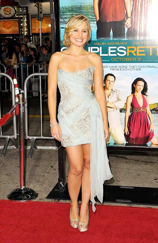 """Kristen Bell was the belle of the ball at the Los Angeles premiere of """"Couples Retreat"""" in a strapless Marchesa frock with stunning chiffon detailing. The blond bombshell completed her look with a simple diamond tennis bracelet, satin Louboutin peep-toes, and a loose updo. Jason Merritt/<a href=""""http://www.gettyimages.com/"""" target=""""new"""">GettyImages.com</a> - October 5, 2009"""