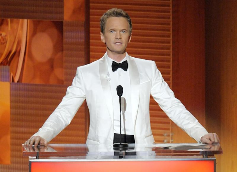 FILE - This Sept. 20, 2009 file photo shows host Neil Patrick Harris during the 61st Primetime Emmy Awards in Los Angeles. Harris will host the Emmys again. CBS will air the Emmycast live from Los Angeles on Sept. 22. (AP Photo/Mark J. Terrill, file)