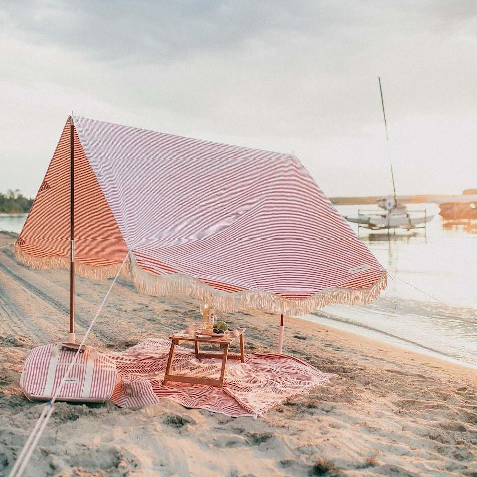 """<h2>Business & Pleasure Co. The Premium Tent</h2><br>What's a beach trip without a few Instagram-worthy photos to give those at home a little dose of FOMO? We're big fans of Business & Pleasure Co.'s beautiful, vintage-inspired beach accessories, and this pretty tent doesn't disappoint.<br><br><em><strong>Shop <a href=""""https://www.westelm.com/shop/collaborations/business-pleasure/?"""" rel=""""nofollow noopener"""" target=""""_blank"""" data-ylk=""""slk:Business & Pleasure Co."""" class=""""link rapid-noclick-resp"""">Business & Pleasure Co.</a></strong></em><br><br><strong>Business & Pleasure Co.</strong> The Premium Tent, $, available at <a href=""""https://go.skimresources.com/?id=30283X879131&url=https%3A%2F%2Fwww.westelm.com%2Fproducts%2Flcl-business-pleasure-co-the-premium-tent-d10964%2F"""" rel=""""nofollow noopener"""" target=""""_blank"""" data-ylk=""""slk:West Elm"""" class=""""link rapid-noclick-resp"""">West Elm</a>"""