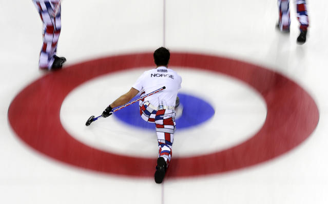 Norway's skip Thomas Ulsrud delivers the rock during the men's curling competition against the United States at the 2014 Winter Olympics, Monday, Feb. 10, 2014, in Sochi, Russia. (AP Photo/Wong Maye-E)