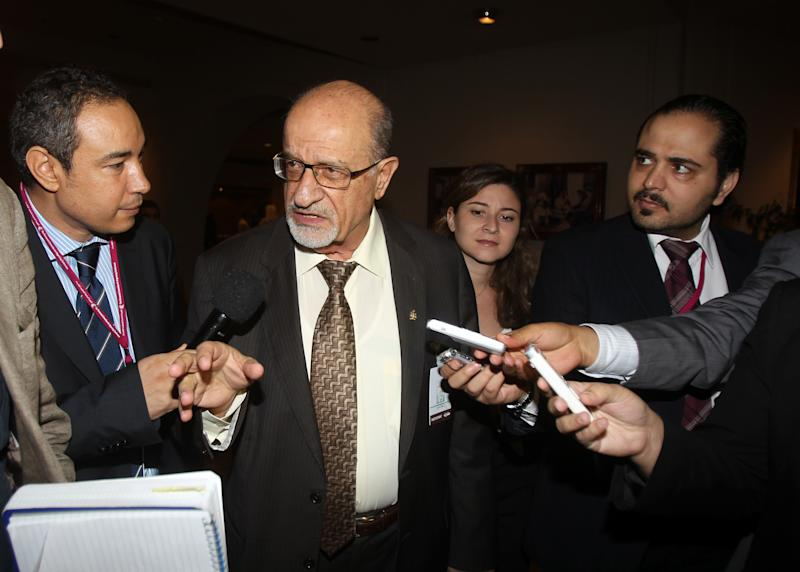 Syrian regime opponent Haytham al-Maleh, center, to reporters on the sidelines of the General Assembly of the Syrian National Council (SNC) meeting in Doha, Qatar,Thursday, Nov. 8, 2012. (AP Photo/Osama Faisal)