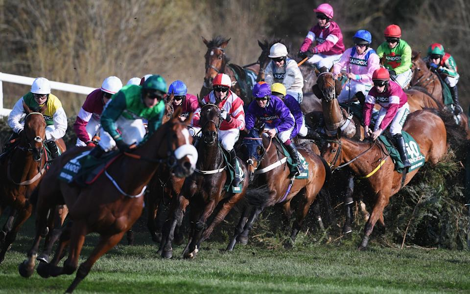 Runners and riders jump Canal Turn during the 2018 Randox Health Grand National at Aintree - Getty Images