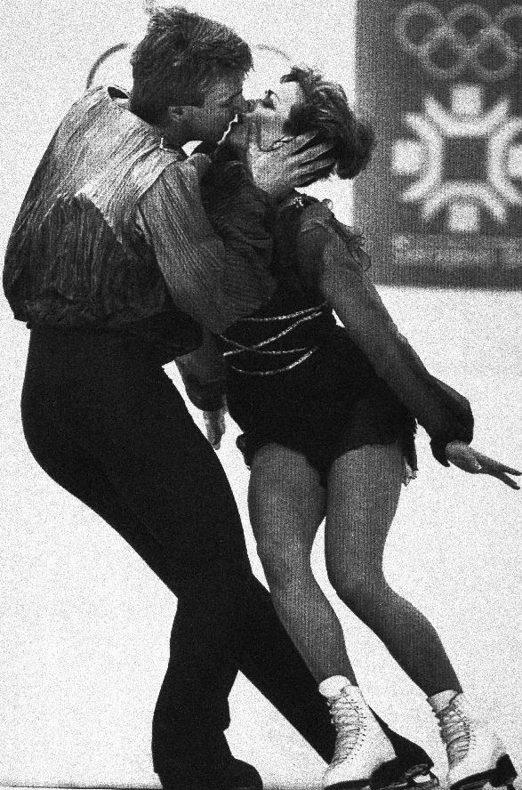 FILE - In this Feb. 14, 1984, file photo, Great Britain's Jayne Torvill and Christopher Dean kiss during their performance in Olympic ice dancing at the Winter Olympics in Sarajevo, Bosnia-Herzegovina. Three decades after their gold medal-winning performance in 1984, Torvill, 54, and Dean, 55, are returning to the ice Thursday, Feb. 13, 2014, dancing the same routine at the same rink. (AP Photo/File)