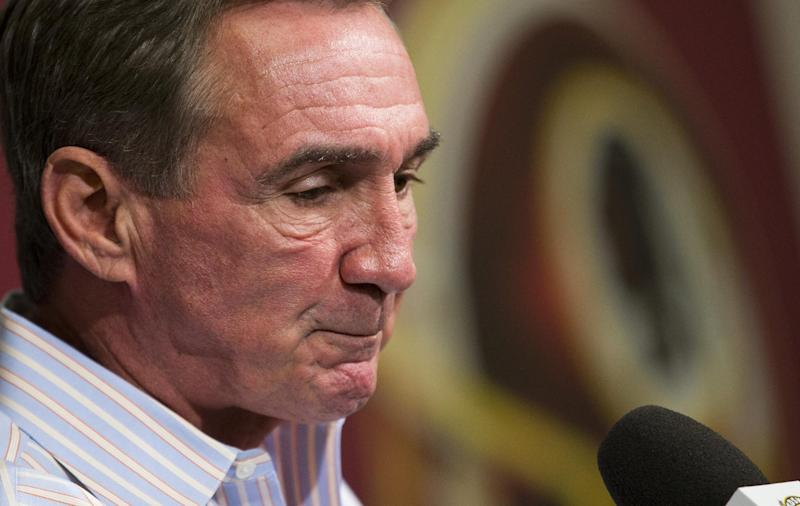 Former Washington Redskins head coach Mike Shanahan makes a statement after he was fired on Monday, Dec. 30, 2013 at Redskins Park, in Ashburn, Va. Shanahan was fired after a morning meeting with owner Dan Snyder and general manager Bruce Allen. (AP Photo/ Evan Vucci)