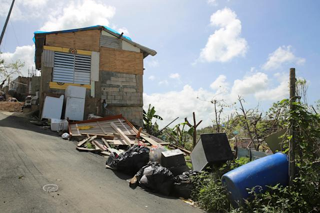 Debris gathers on the streets in Canóvanas, Puerto Rico on Oct. 14, 2017.