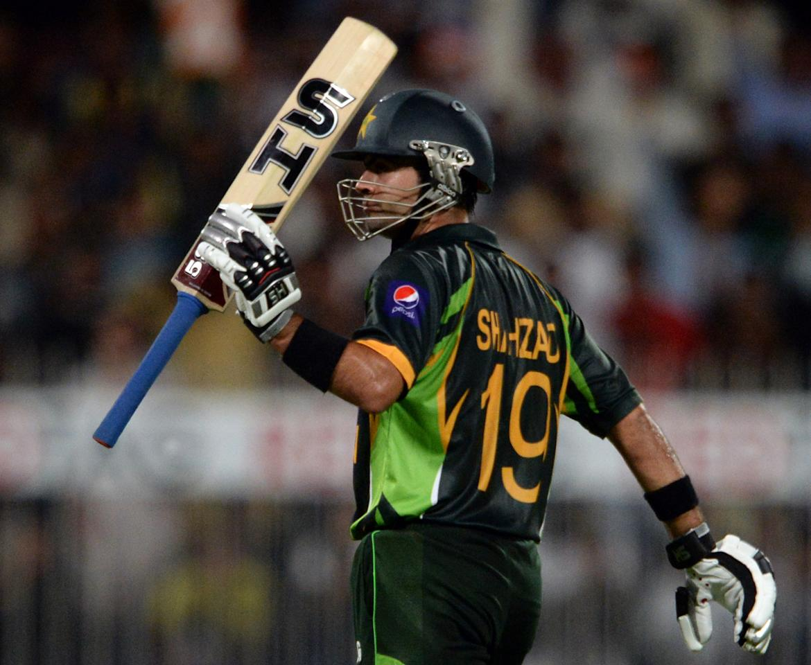 Pakistan's cricketer Ahmad Shehzad celebrates after making fifty runs during the first one-day in Sharjah Cricket Stadium in Sharjah on October 30, 2013. South African captain AB de Villiers won the toss and decided to bat in the first of five one-day internationals against Pakistan in Sharjah. AFP PHOTO/ASIF HASSAN        (Photo credit should read ASIF HASSAN/AFP/Getty Images)