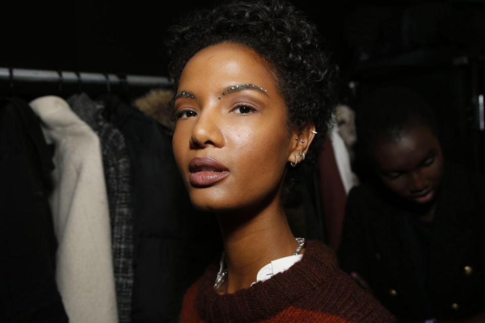 <p>Meanwhile at Christopher John Rogers, crystal-studded arches gave us serious brow envy. Use a little lash glue to help the crystals stick.</p>