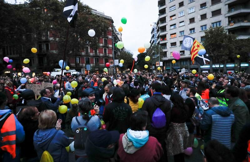 Pro-independence activists gather with balloons during a protest outside the Spanish government delegation offices in Barcelona