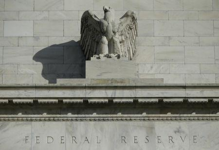 Wall St. closes slightly higher after Fed policy decisions