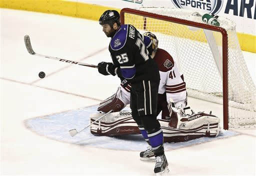 Phoenix Coyotes' Mike Smith (41) gets shielded by Los Angeles Kings' Dustin Penner (25) as Kings' Mike Richards scores a goal in the second period of an NHL hockey game Tuesday, March 12, 2013, in Glendale, Ariz. (AP Photo/Ross D. Franklin)