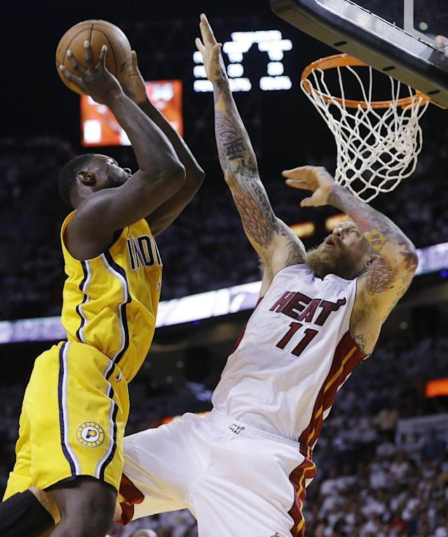 Indiana Pacers guard Lance Stephenson (1) drives to the basket as Miami Heat forward Chris Andersen (11) defends during the first half of Game 3 in the NBA basketball Eastern Conference finals playoff series, Saturday, May 24, 2014, in Miami. (AP Photo/Lynne Sladky)