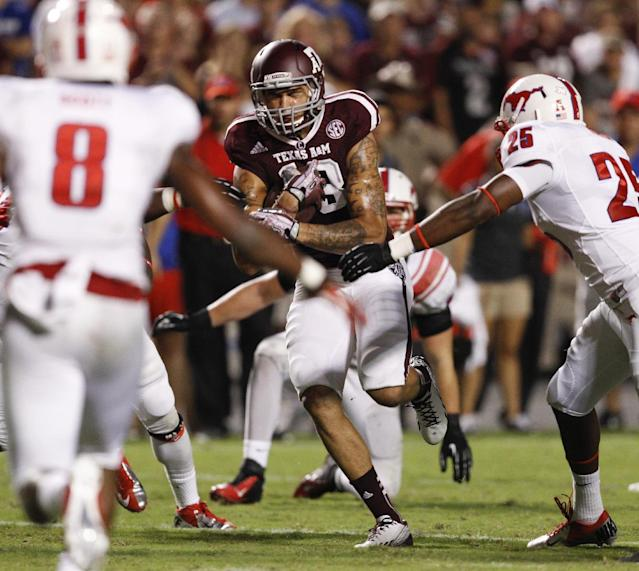 Texas A&M wide receiver Mike Evans (13) runs past SMU linebacker Nick Horton (25) with the ball after completing a pass in the second quarter of an NCAA college football game Saturday, Sept. 21, 2013, in College Station, Texas. (AP Photo/Bob Levey)