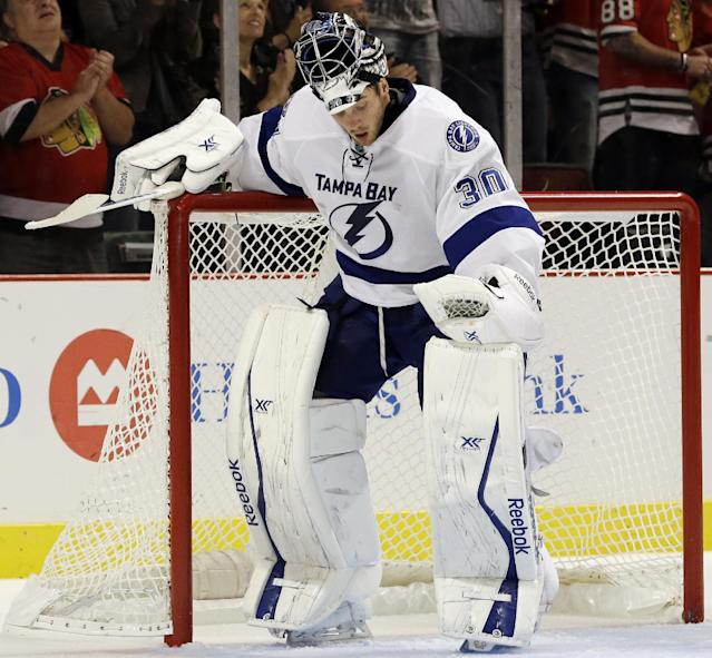 Tampa Bay Lightning goalie Ben Bishop reacts after Chicago Blackhawks' Brandon Saad scored a goal during the second period of an NHL hockey game in Chicago, Saturday, Oct. 5, 2013. (AP Photo/Nam Y. Huh)