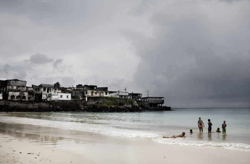 Children play on a beach of Moroni, the capital of Comoros, on March 6, 2008