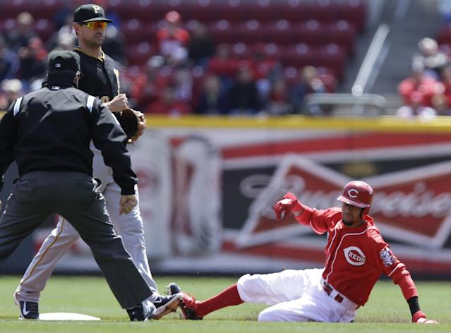 Cincinnati Reds' Billy Hamilton, right, steals second base as Pittsburgh Pirates second baseman Neil Walker waits for the ball in the first inning of a baseball game, Wednesday, April 16, 2014, in Cincinnati. (AP Photo/Al Behrman)