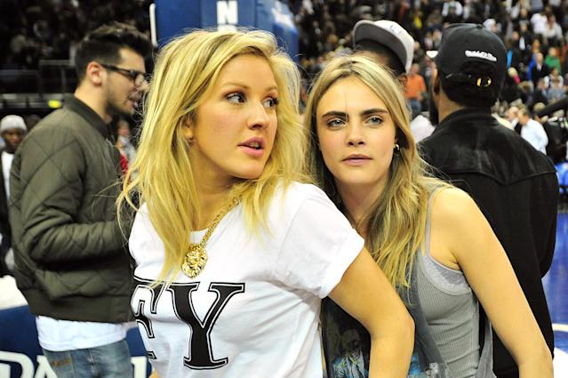 <p>Cara Delevingne and singer Ellie Goulding (left) attend the NBA Global Games London 2014 match between Atlanta Hawks and Brooklyn Nets in 2014. </p>