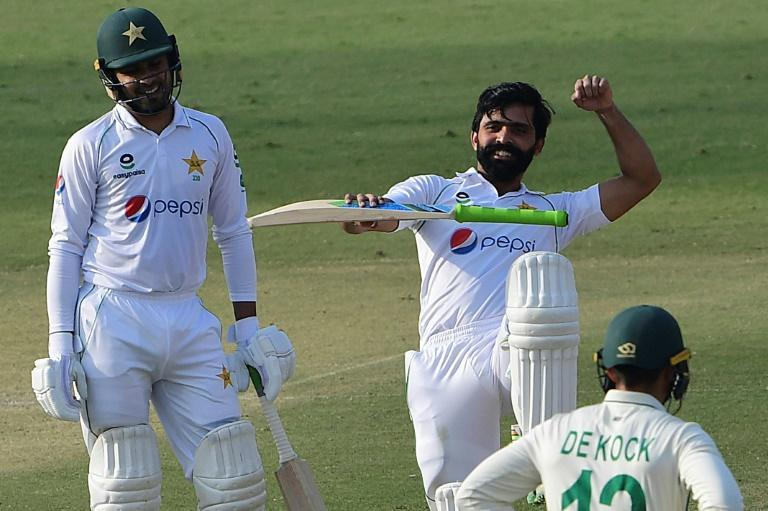 Pakistan's Fawad Alam celebrates after reaching his century while teammate Faheem Ashraf looks on