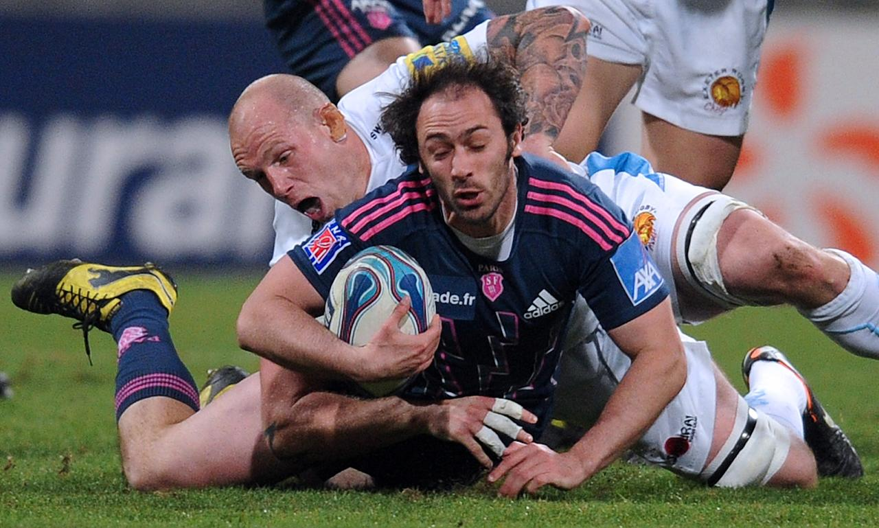 Stade Francais' scrum-half Julien Dupuy (foreground) is tackled by flanker James Scaysbrook of Exeter Chiefs during the European Challenge Cup quarter final rugby union match Stade Francais vs. Exeter at the Charlety stadium in Paris on April 5, 2012. AFP PHOTO / FRANCK FIFE (Photo credit should read FRANCK FIFE/AFP/Getty Images)