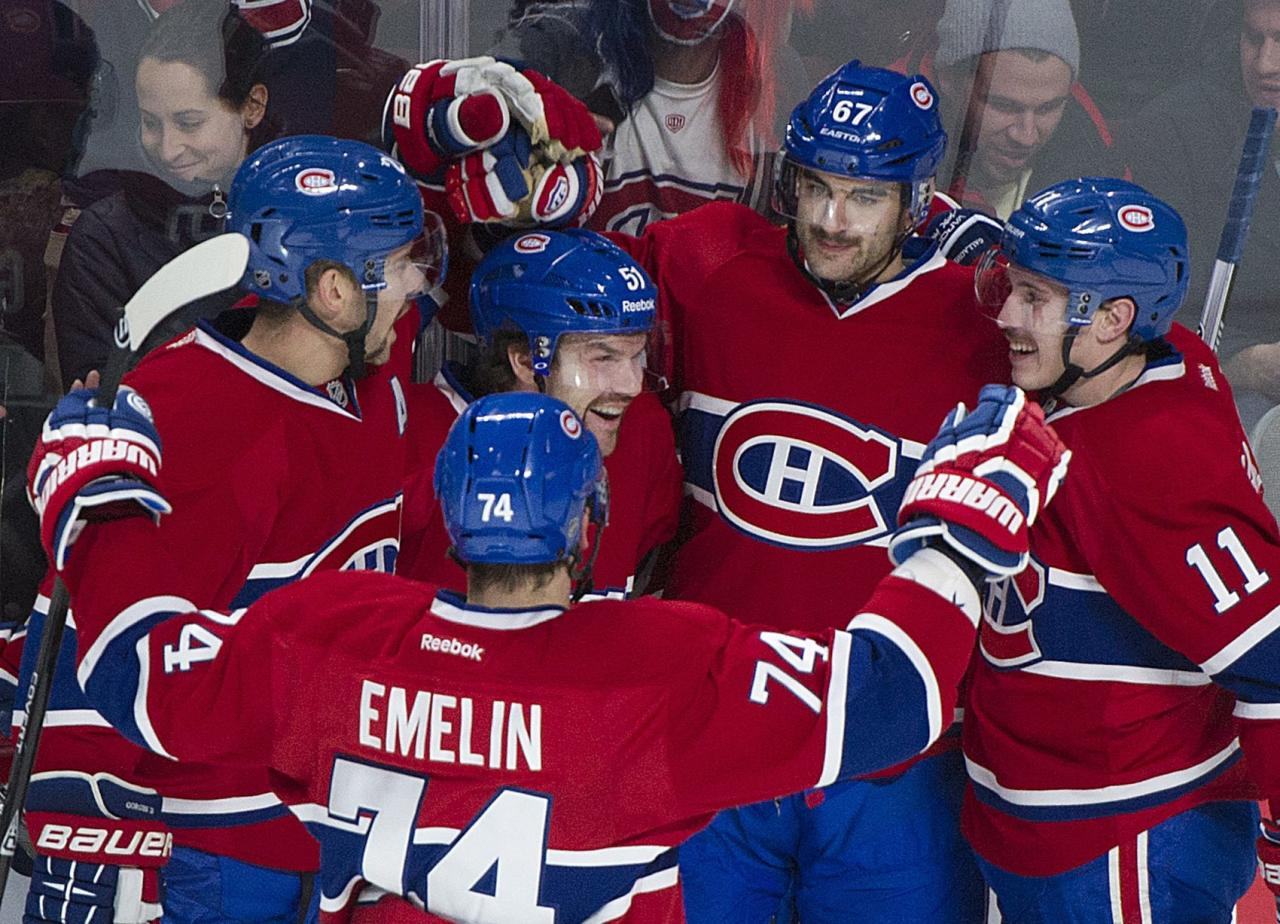 Montreal Canadiens' Max Pacioretty (67) celebrates with teammates Josh Gorges, left, Alexei Emelin, Brendan Gallagher (11) and David Desharnais (51) after scoring against the Pittsburgh Penguins during second-period NHL hockey game action in Montreal, Saturday, Nov. 23, 2013. (AP Photo/The Canadian Press, Graham Hughes)