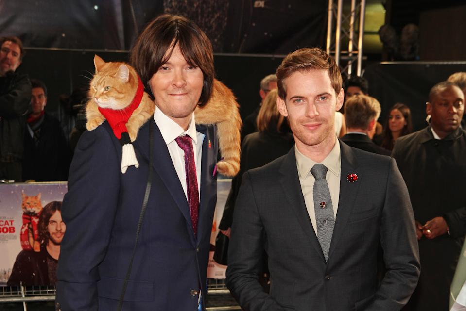 "James Bowen with Bob The Cat and Luke Treadaway at the UK Premiere of ""A Street Cat Named Bob"" on November 3, 2016. (Photo by David M. Benett/WireImage)"