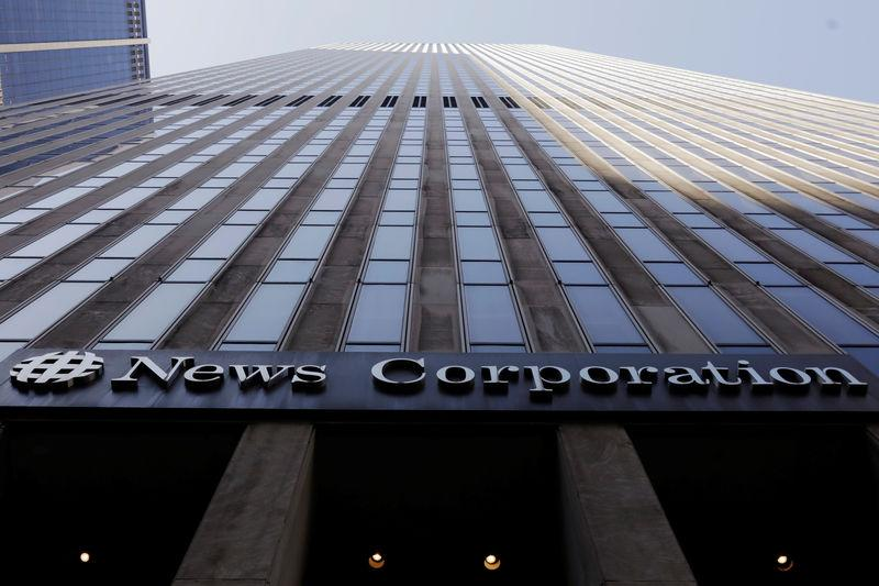 The News Corporation logo is displayed on the side of a building in midtown Manhattan in New York