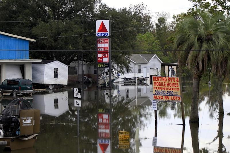 Floodwaters from Hurricane Isaac inundate structures in Scaresdale , La., Sunday, Sept. 2, 2012. More than 200,000 people across Louisiana still didn't have any power five days after Hurricane Isaac ravaged the state. Thousands of evacuees remained at shelters or bunked with friends or relatives. (AP Photo/Gerald Herbert)