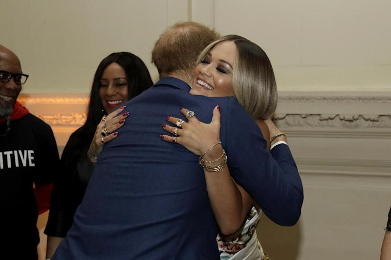 Prince Harry hugs British singer Rita Ora during a reception before the charity concert (AP)