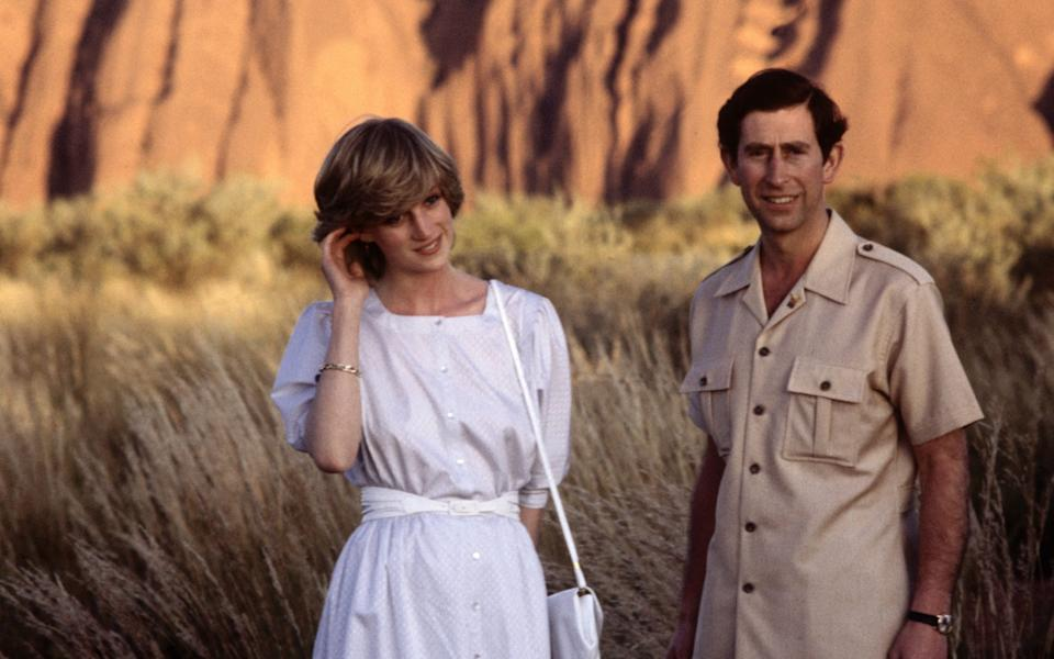 Diana Princess of Wales and Prince Charles pose in front of Ayer's Rock (now Uluru) in 1983 - Getty