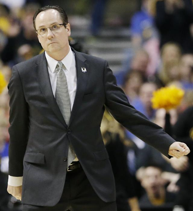 Wichita State head coach Gregg Marshall watches action against Kentucky during the first half of a third-round game of the NCAA college basketball tournament Sunday, March 23, 2014, in St. Louis. (AP Photo/Charlie Riedel)