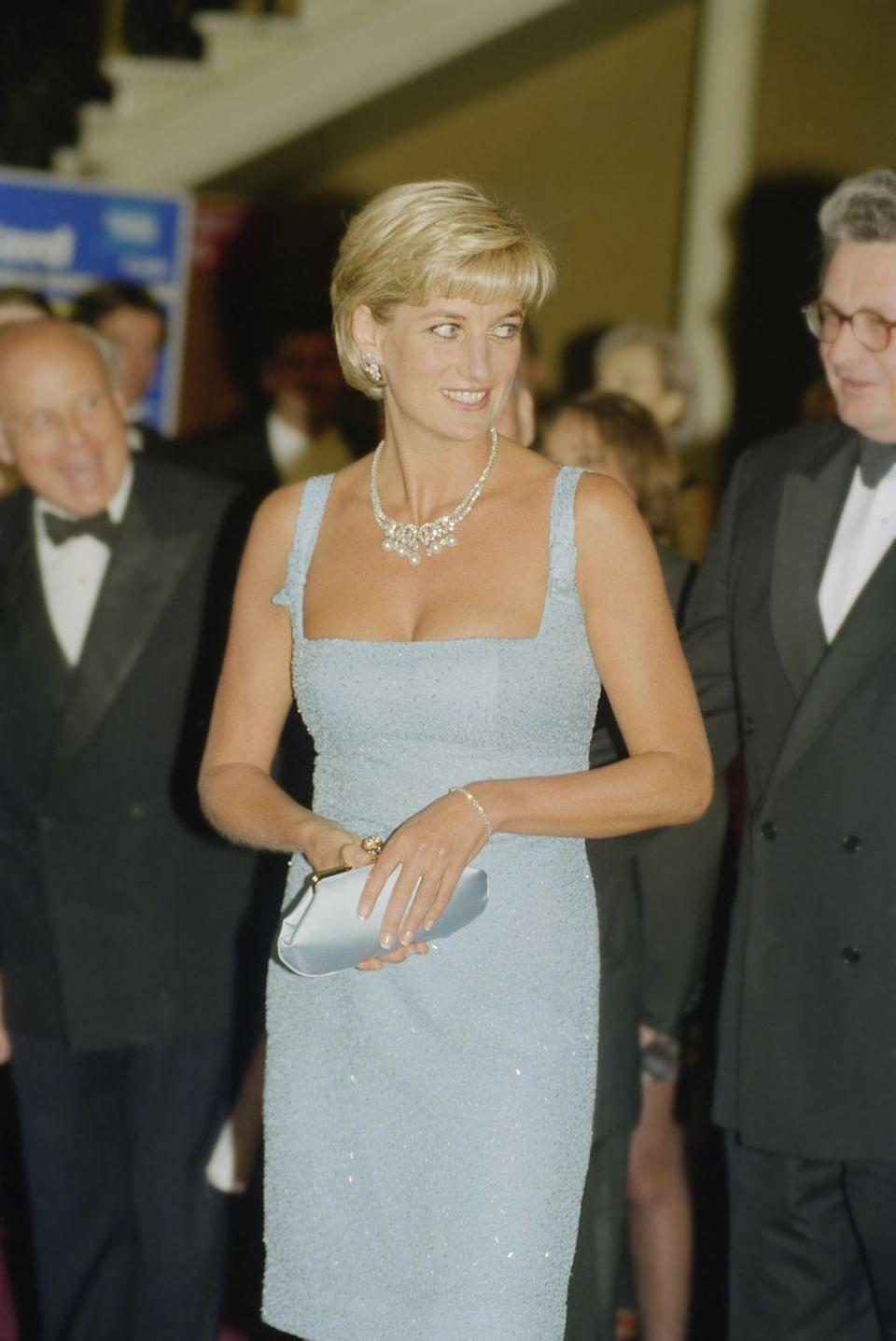 """<p>The late Princess Diana was the queen of clutches—she <a href=""""https://www.cosmopolitan.com/style-beauty/fashion/g19643527/royal-family-fashion-rules/"""" rel=""""nofollow noopener"""" target=""""_blank"""" data-ylk=""""slk:even used them for a secret trick!"""" class=""""link rapid-noclick-resp"""">even used them for a secret trick!</a> But chic satin ones, like this powder-blue bag, were definitely her fave.</p>"""