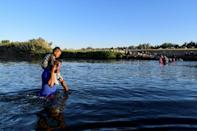 Haitian migrants cross the Rio Grande river from Ciudad Acuna, Mexico, to the United States. (AFP/PEDRO PARDO)
