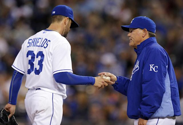 Kansas City Royals manager Ned Yost, right, takes the ball from starting pitcher James Shields (33) during the seventh inning of a baseball game against the Detroit Tigers in Kansas City, Mo., Friday, May 2, 2014. Shields was replaced by relief pitcher Kelvin Herrera. (AP Photo/Orlin Wagner)
