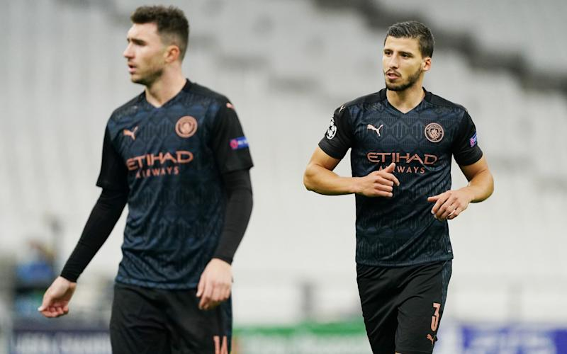 Aymeric Laporte and Ruben Dias of Manchester City during the UEFA Champions League Group C stage match between Olympique de Marseille and Manchester City at Stade Velodrome on October 27, 2020 in Marseille, France. - GETTY IMAGES