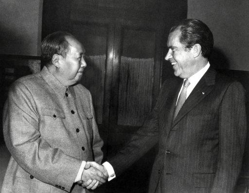 The historic handshake between Chinese leader Mao Tse-tung (L) and Richard Nixon in 1972