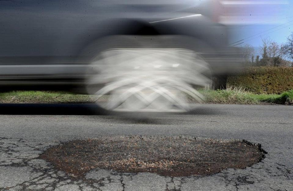 Reducing potholes and cracks on England's motorways and major A roads is drivers' top priority for improvement (PA) (PA Wire)