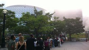 Hundreds line up on a fog-filled morning Saturday morning to get access to the funeral for NDP Leader Jack Layton at Toronto's Roy Thomson Hall.