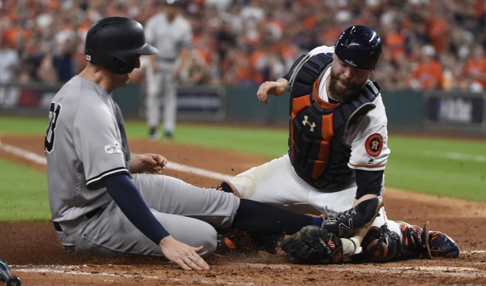 Houston Astros catcher Brian McCann tags out New York Yankees' Greg Bird at home during the fifth inning of Game 7 of baseball's American League Championship Series Saturday, Oct. 21, 2017, in Houston. (AP)