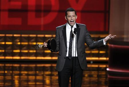 """Jon Cryer accepts the award for outstanding lead actor in a comedy series for his role in """"Two and a Half Men"""" at the 64th Primetime Emmy Awards in Los Angeles, September 23, 2012. REUTERS/Lucy Nicholson/Files"""