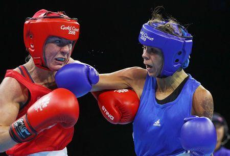 Boxing - Gold Coast 2018 Commonwealth Games - Women's 51kg Final Bout - Oxenford Studios - Gold Coast, Australia - April 14, 2018. Lisa Whiteside of England (red) v Carly McNaul of Northern Ireland (blue). REUTERS/Athit Perawongmetha
