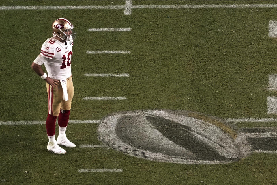 San Francisco 49ers quarterback Jimmy Garoppolo (10) stands on the field during the second half of Super Bowl LIV. (AP Photo/Morry Gash)