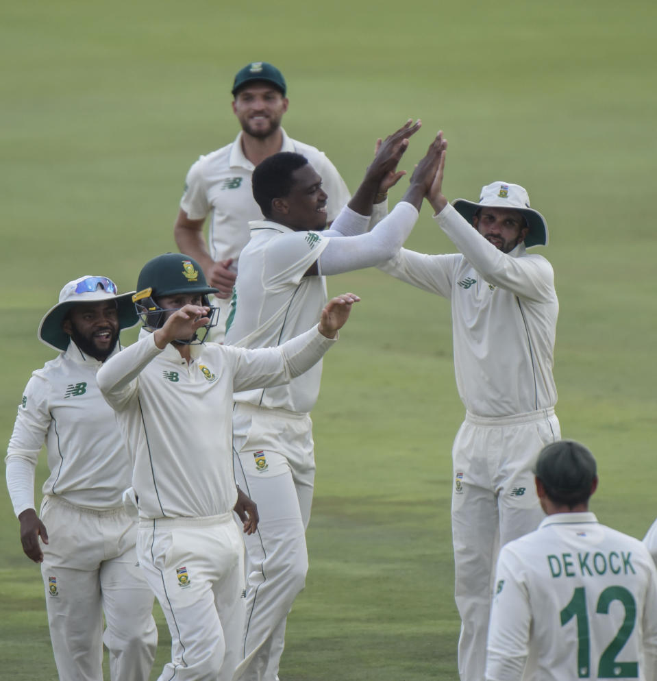 South AfricaCelebrate the second wicket on day three of the first cricket test match between South Africa and Sri Lanka at Super Sport Park Stadium in Pretoria, South Africa, Monday Dec. 28, 2020. (AP Photo/Catherine Kotze)