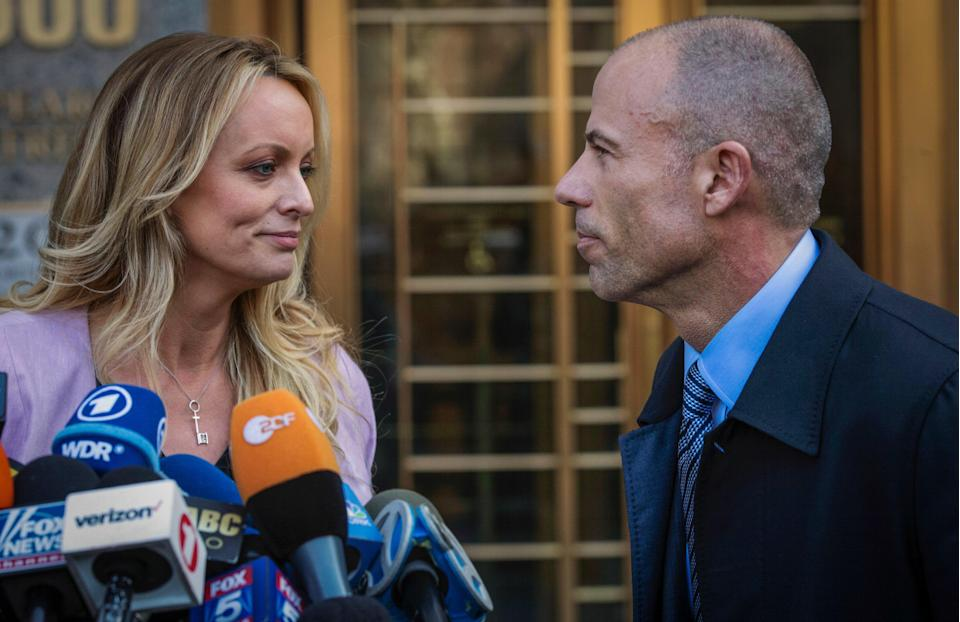 <p>In this April 16, 2018, file photo, adult film actress Stormy Daniels, left, stands with her then lawyer, Michael Avenatti, during a press conference outside federal court in New York. </p> (Associated Press)