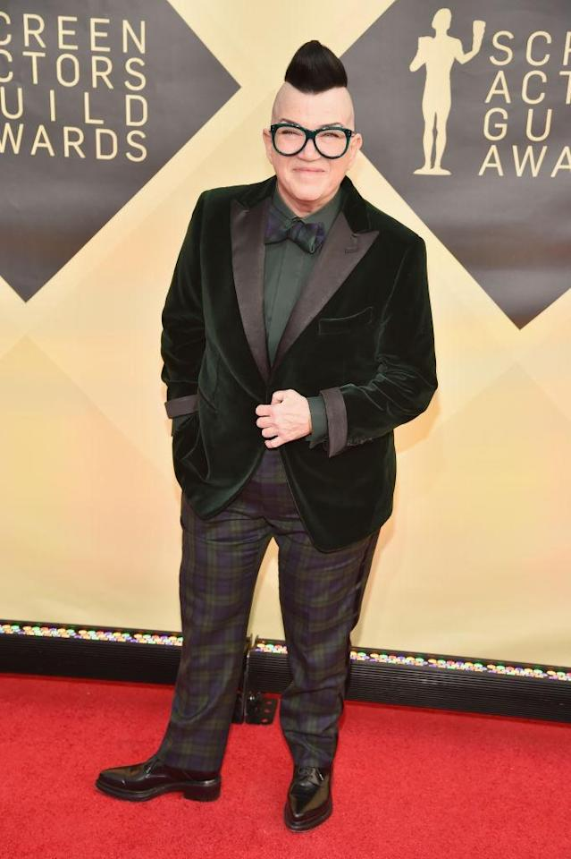 <p>Incorporating two trends into her look, DeLaria wore a green velvet suit jacket with plaid pants. (Photo: Getty Images) </p>