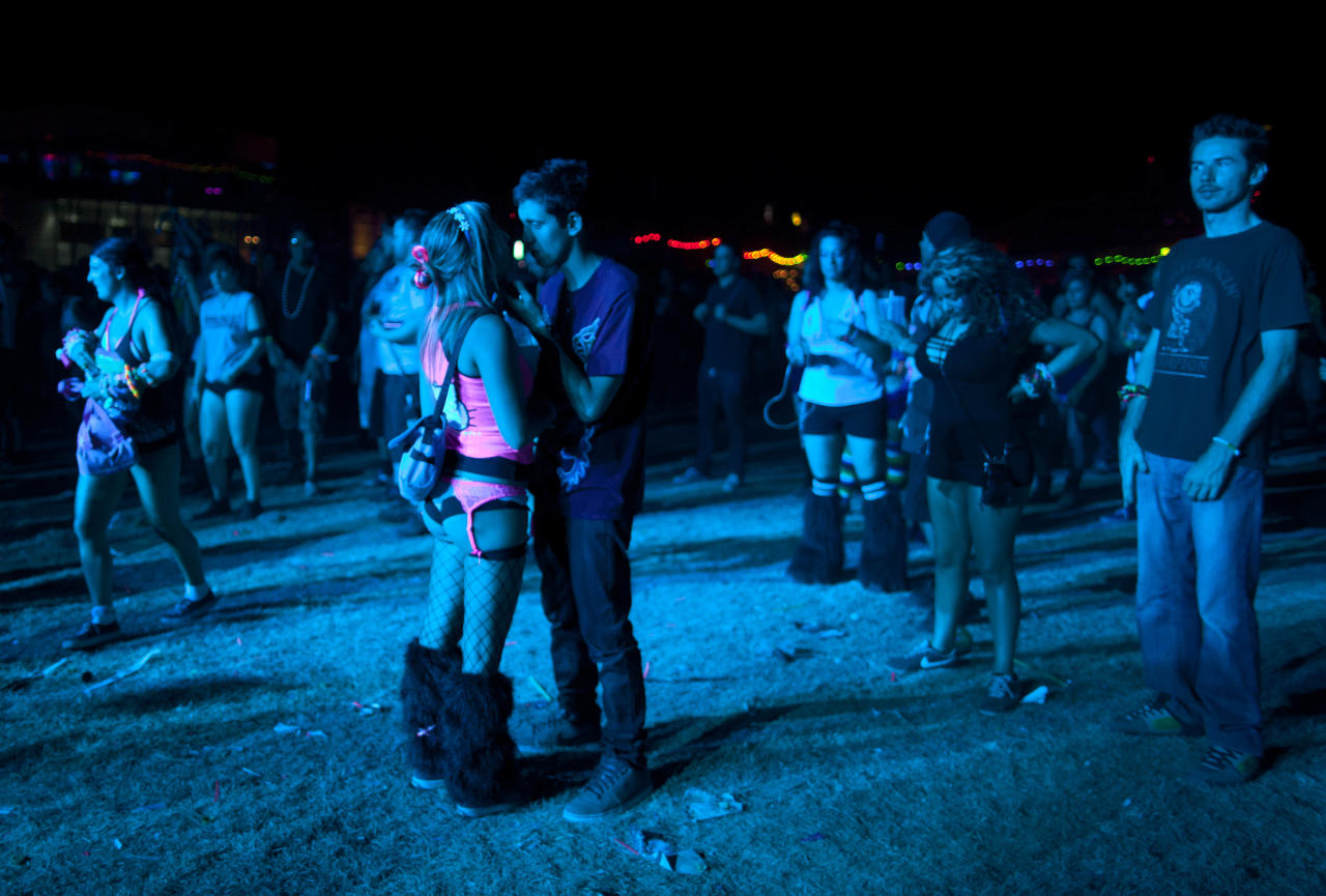 A couple shares a moment together at the Cosmic Meadow stage during the last night of the Electric Daisy Carnival, Sunday, June 26, 2011, in Las Vegas. (AP Photo/Julie Jacobson)