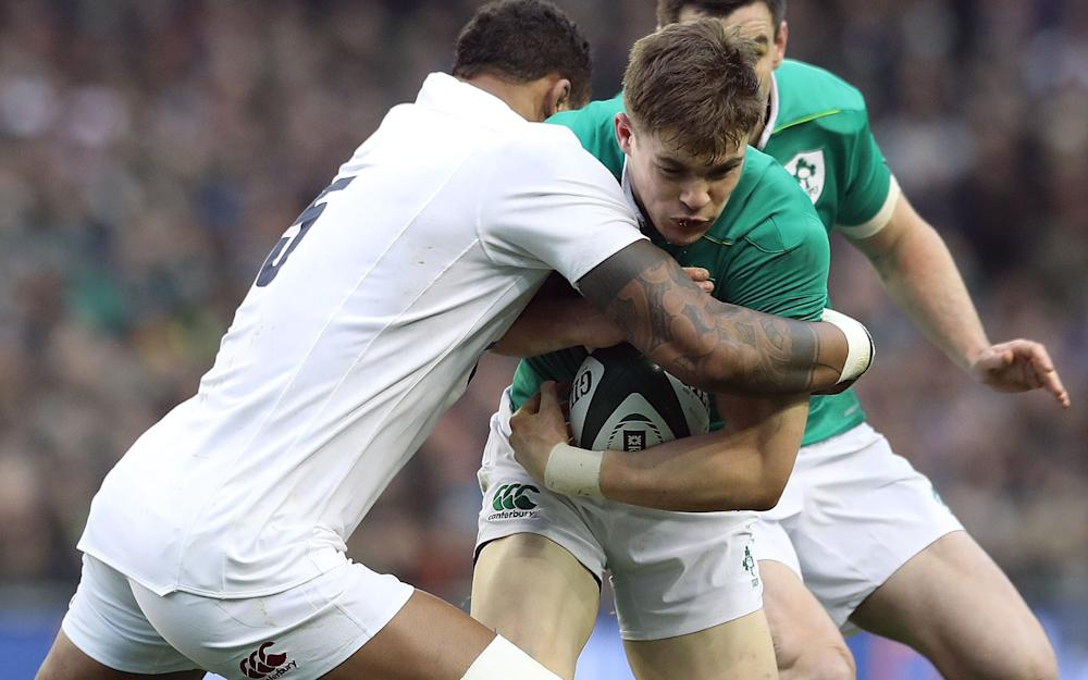 Ireland's Garry Ringrose is tackled by Courtney Lawes - Credit: PA