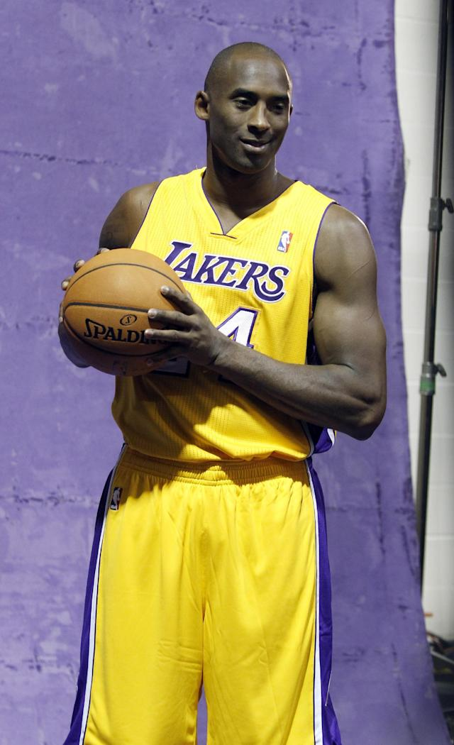 Los Angeles Lakers guard Kobe Bryant stands in a photo booth during the NBA basketball team's media day Saturday, Sept. 28, 2013, in El Segundo, Calif. (AP Photo/Alex Gallardo)