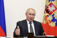 Russian President Vladimir Putin gestures during a meeting with elected heads of Russian regions via video conference at the Novo-Ogaryovo residence outside Moscow, Russia, Thursday, Sept. 24, 2020. Russian health officials have reported 6,595 new coronavirus cases, the highest daily surge since July. In Moscow, more than 1,000 new cases were recorded Thursday for the first time since June. (Mikhail Klimentyev, Sputnik, Kremlin Pool Photo via AP)