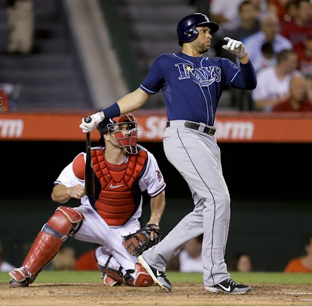 Tampa Bay Rays' James Loney, right, watches his two-run double in front of Los Angeles Angels catcher Chris Iannetta during the third inning of a baseball game in Anaheim, Calif., Thursday, Sept. 5, 2013. (AP Photo/Chris Carlson)